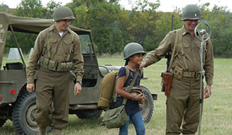 kid with reenactors of World War II